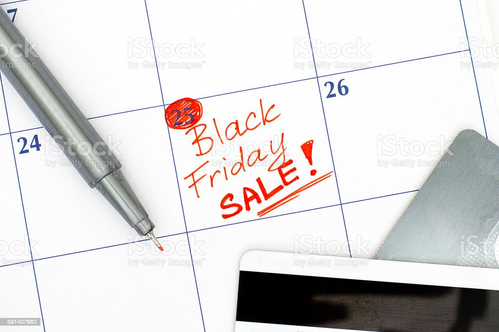 Reminder Black Friday Sale in calendar with credit cards stock photo