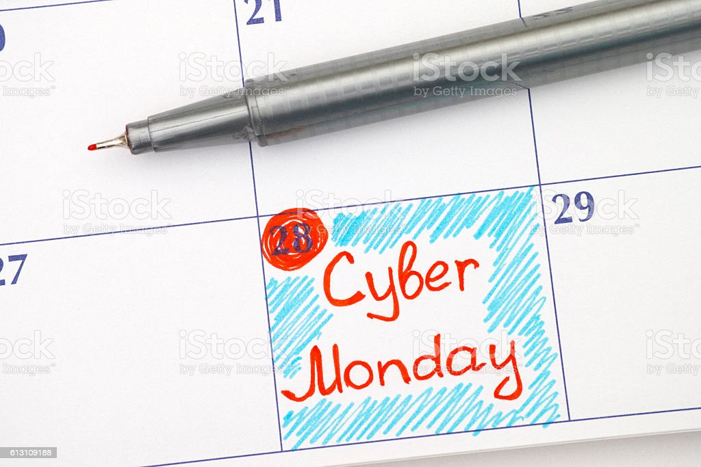 Reminder Cyber Monday in calendar with pen stock photo