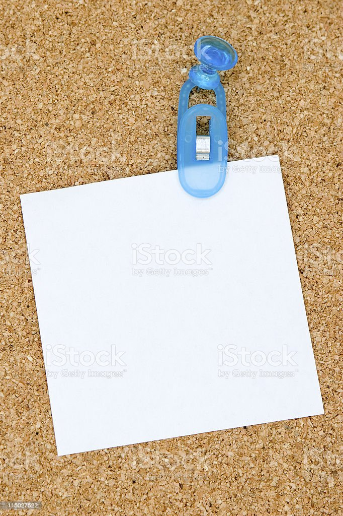 Reminder note stuck to a corkboard royalty-free stock photo