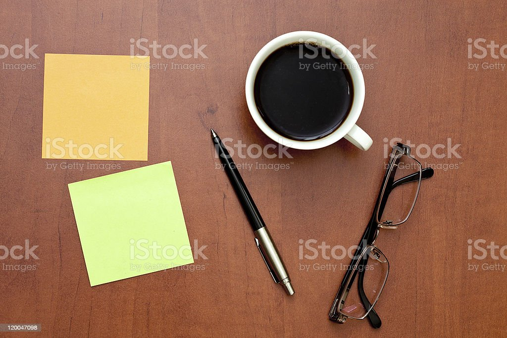 Reminder notes, pen and glasses with cup of coffee royalty-free stock photo
