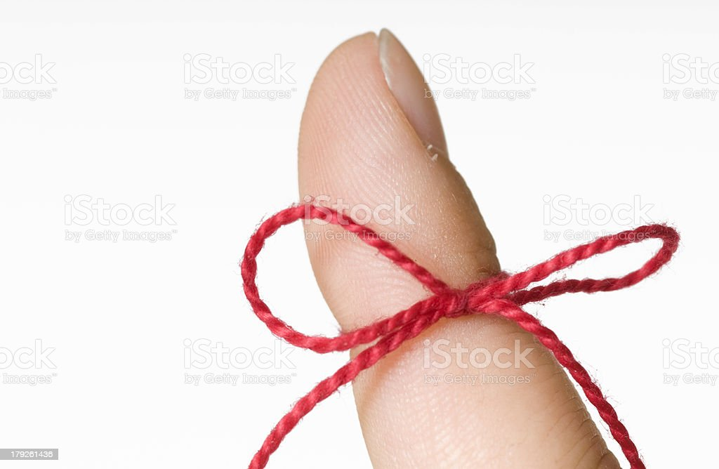 reminder string on a finger royalty-free stock photo