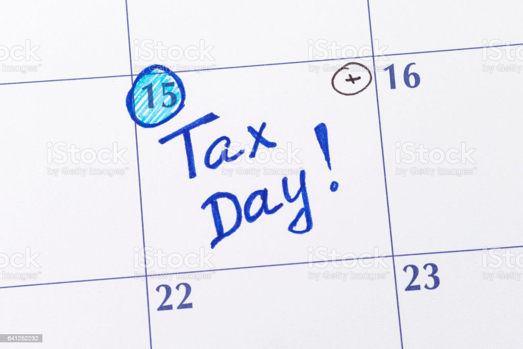 Reminder Tax day in calendar stock photo