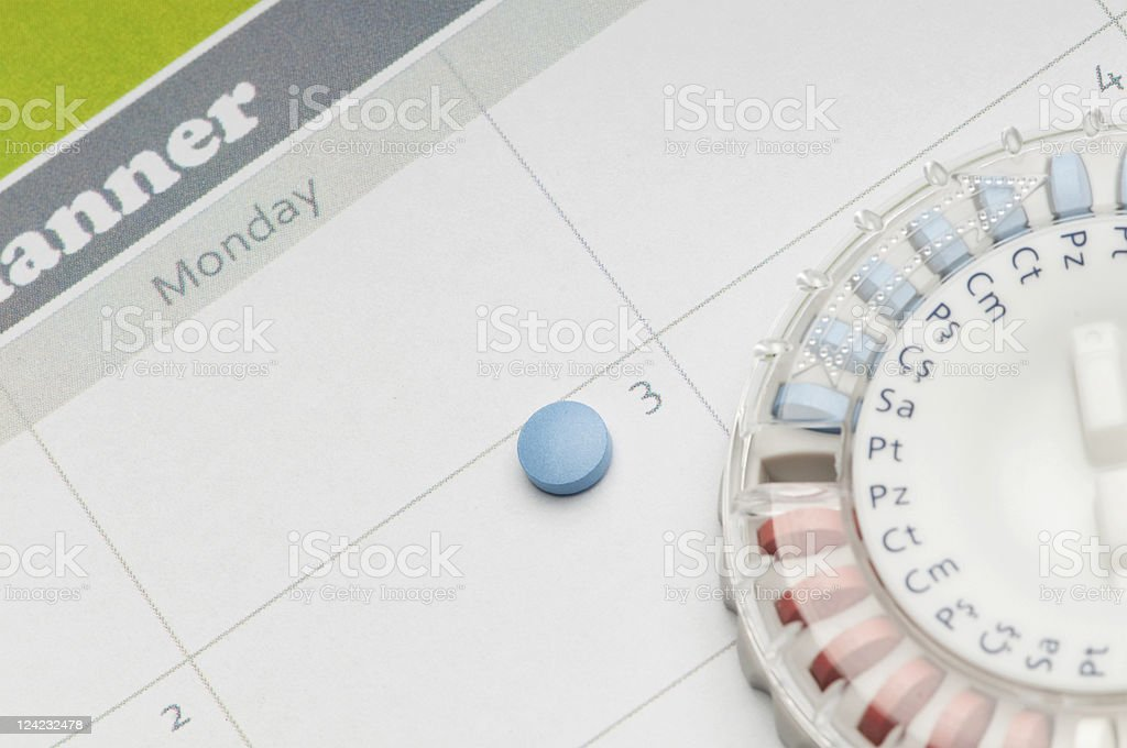 A reminder to take birth control on Monday stock photo