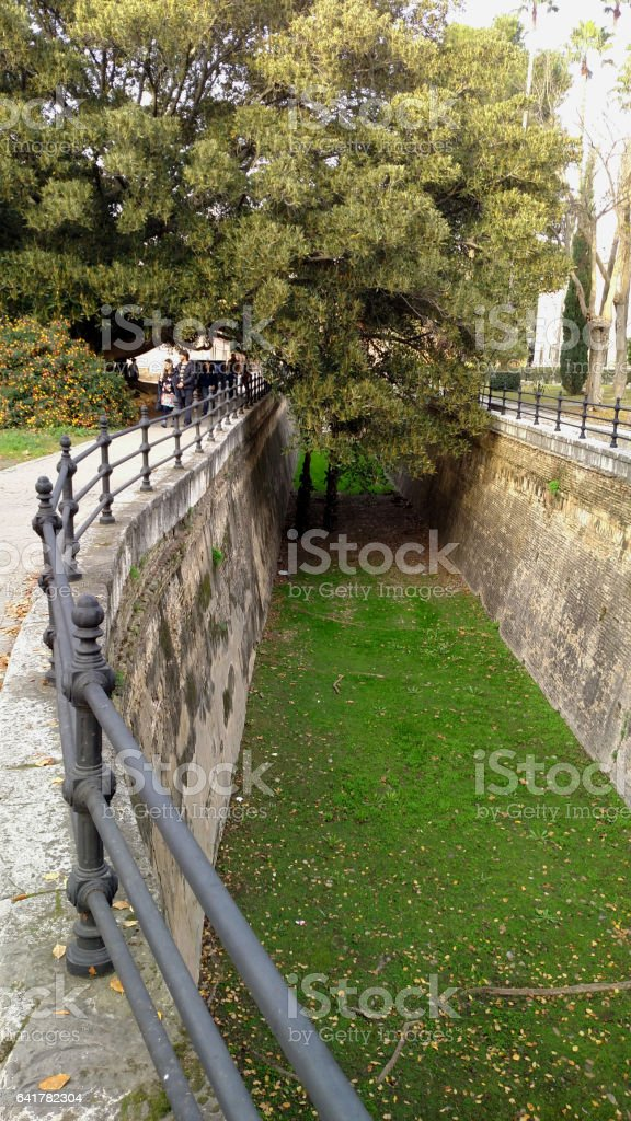 Remnant moat University Faculty of Sciences in downtown Seville Spain stock photo