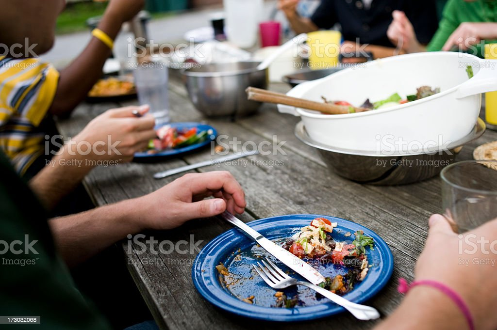 Remnants of a family dinner enjoyed at a rustic table royalty-free stock photo