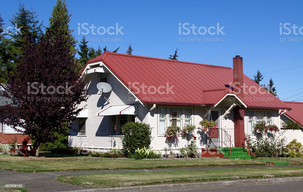 Remodeled Older Home With Metal Roof stock photo