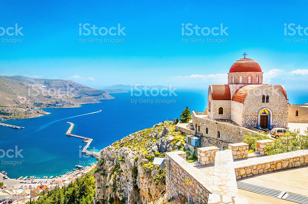 Remote church with red roofing on cliff, Greece stock photo