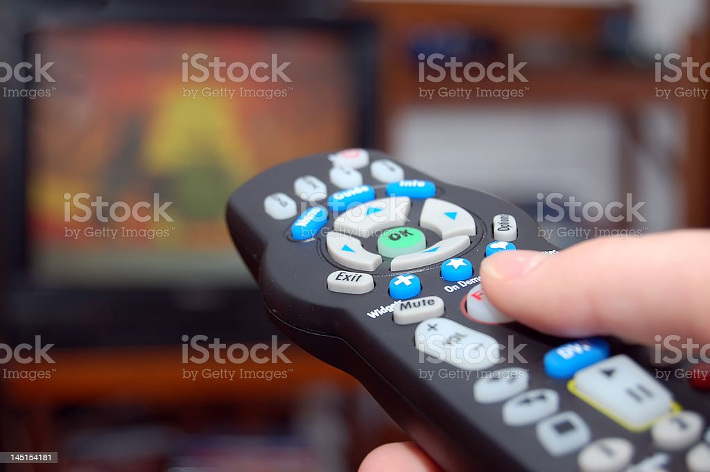 Remote control and TV royalty-free stock photo