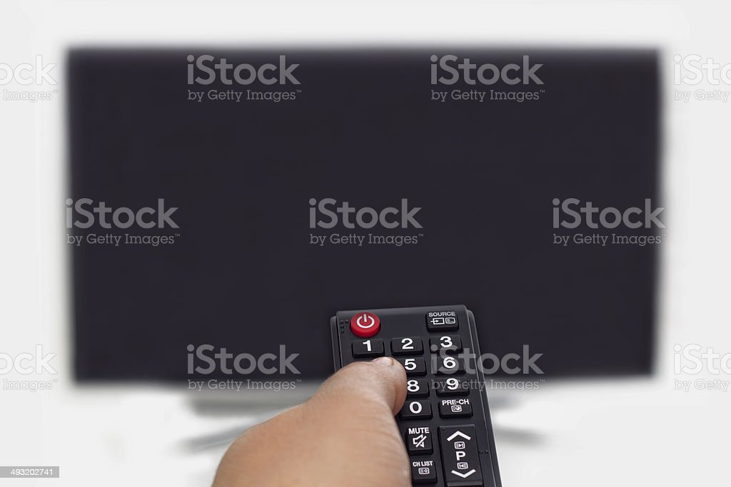 Remote Control and TV stock photo