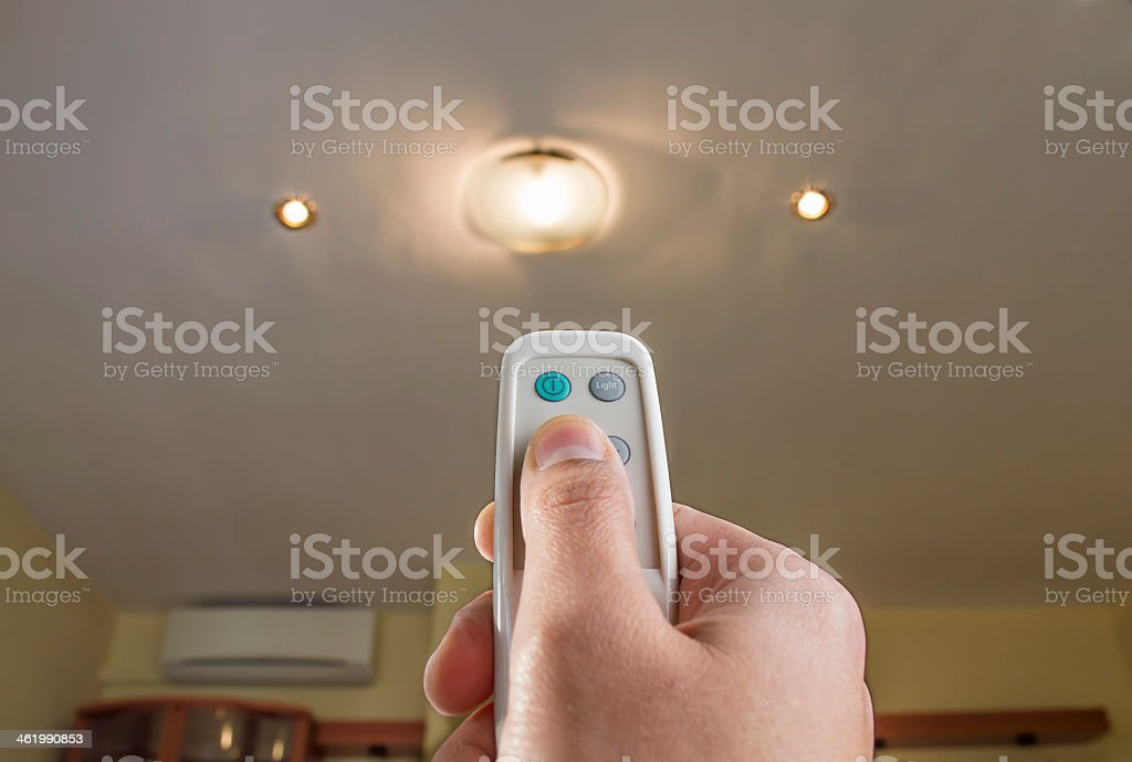 remote control controlling an light stock photo