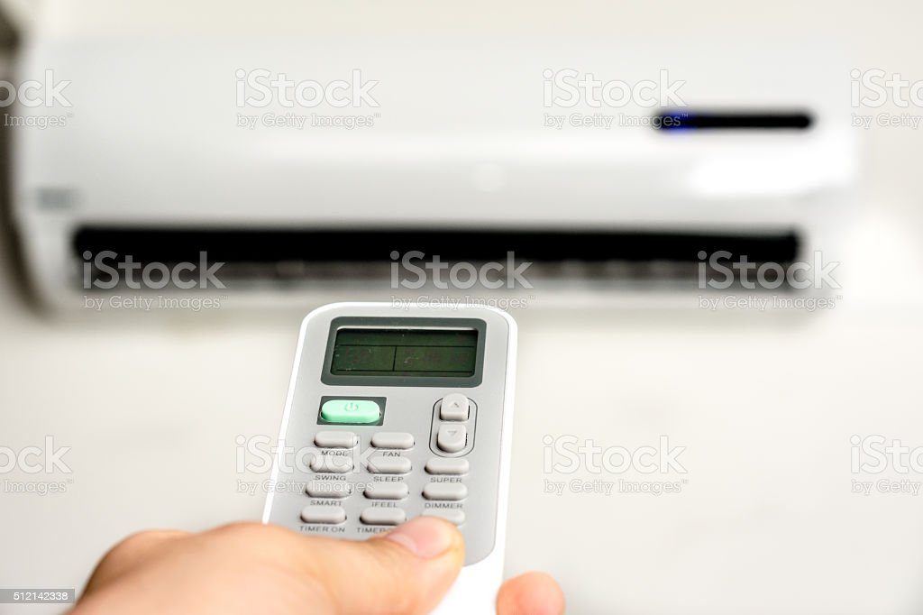 Remote control of air conditioner stock photo