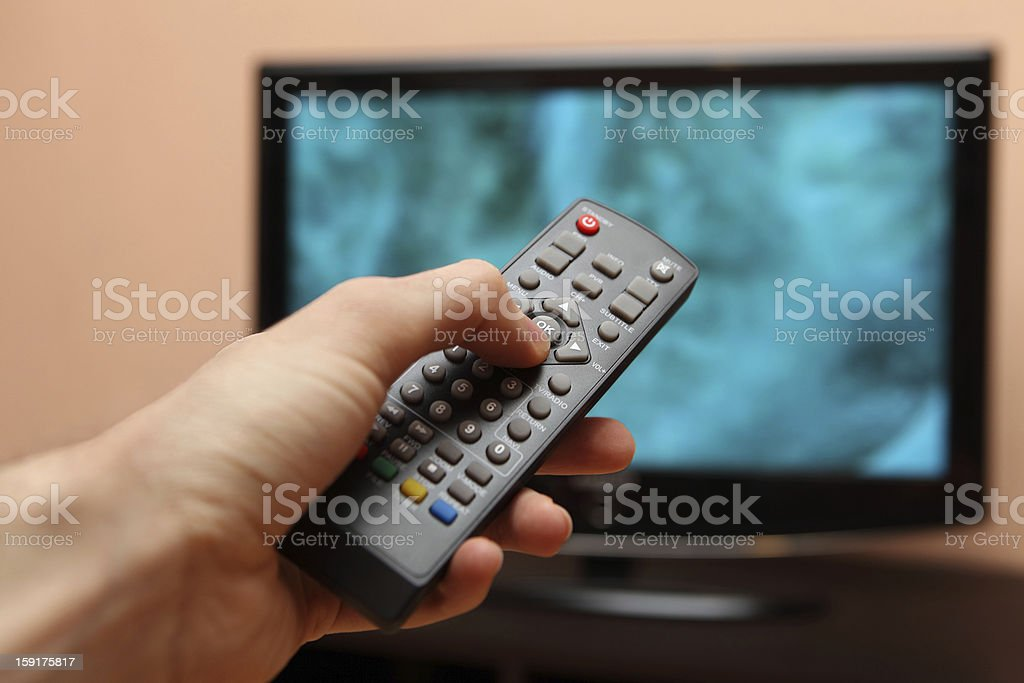 TV remote control with a television in the background stock photo
