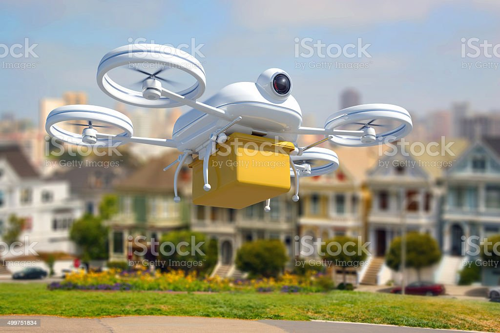 Remote controlled drone delivering mail and package in San Francisco stock photo