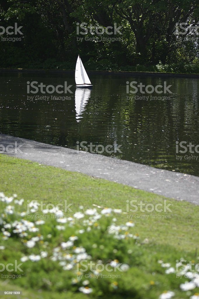 Remote controlled sailboat at park royalty-free stock photo