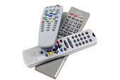 Remote controllers for the TV etc on a white background