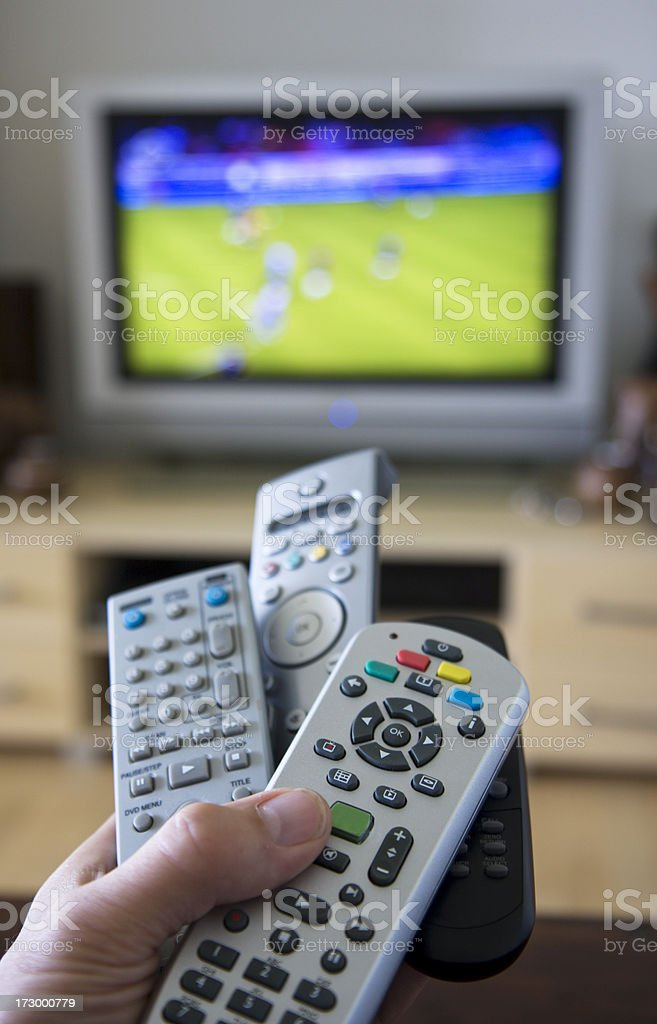 Remote Controls in front of tv. royalty-free stock photo