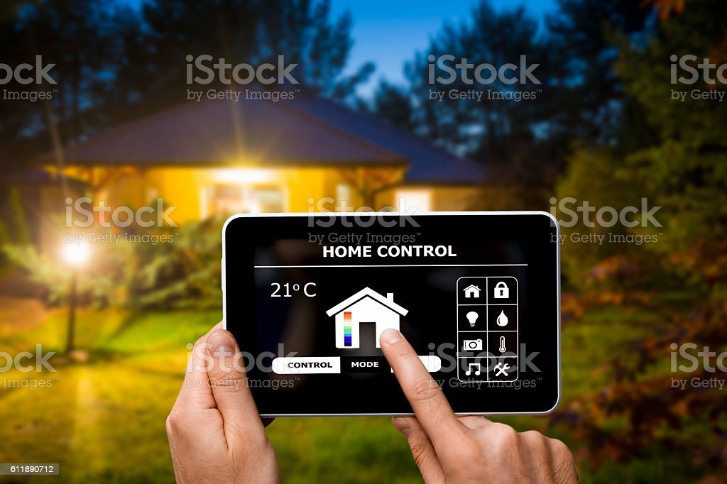 Remote home control system on a digital tablet. stock photo