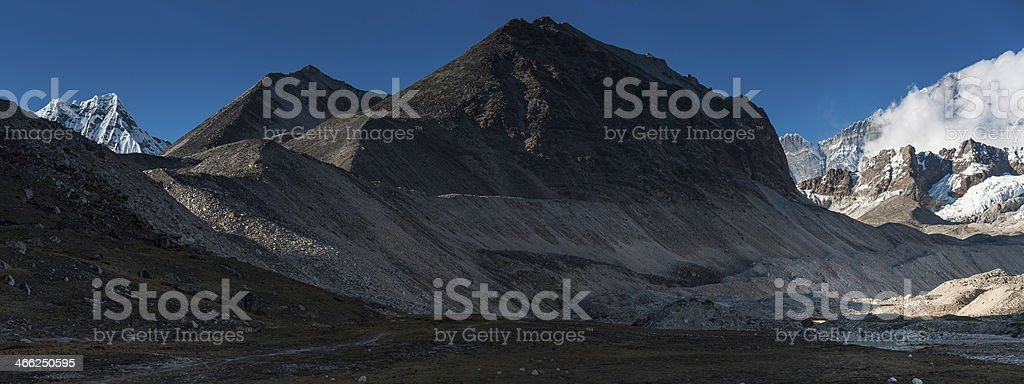 Remote mountain wilderness rocky peaks snowy summits panorama Himalayas stock photo