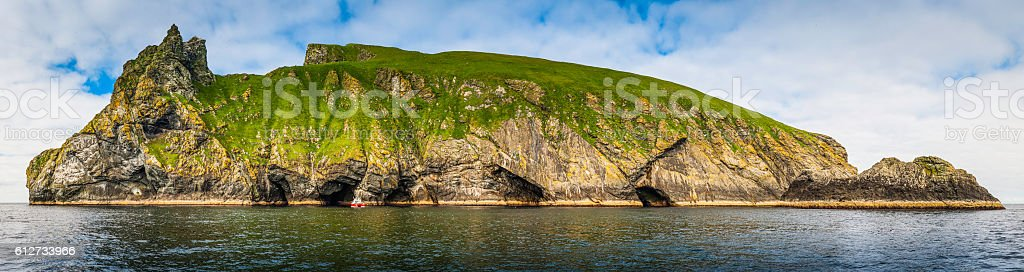 Remote ocean island sea cliff panorama St Kilda Hebrides Scotland stock photo