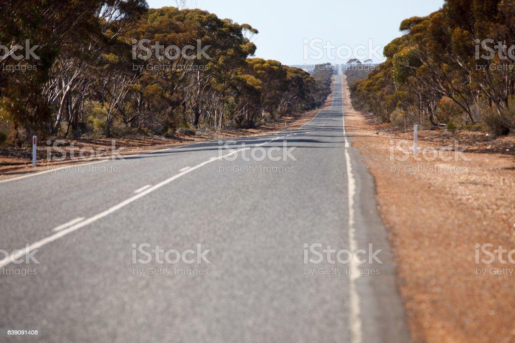 Remote road in australian bush stock photo
