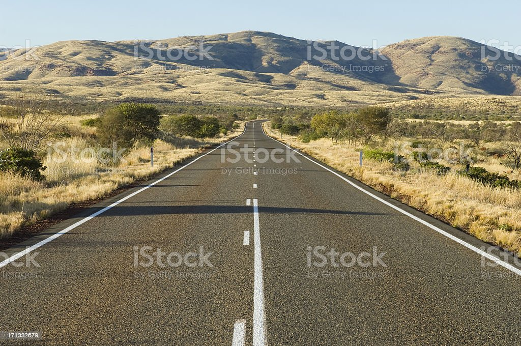 Remote road in the Australian outback. stock photo