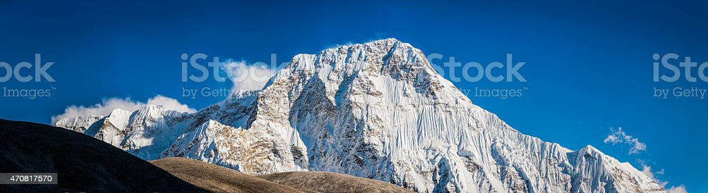 Remote snowy mountain peak pristine wilderness Chamlang 7319m Himalayas Nepal stock photo