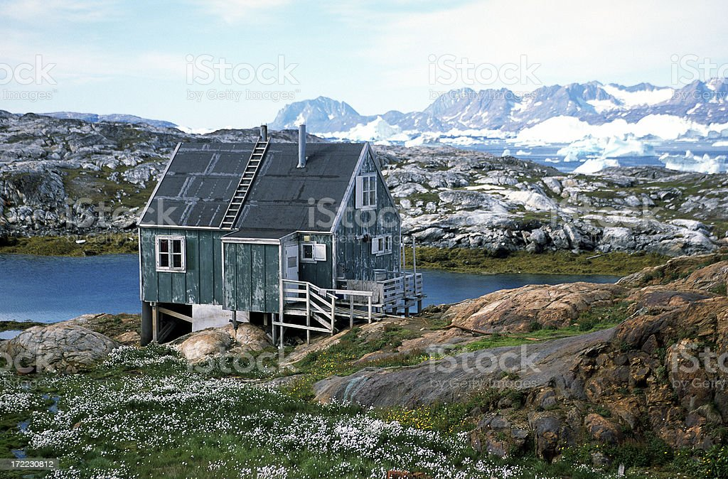 Remote wooden house in Tiniteqilaaq, East Greenland royalty-free stock photo