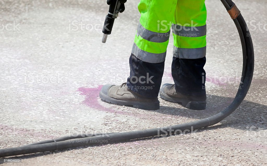 Removal of Graffiti with Dustless Blasting stock photo