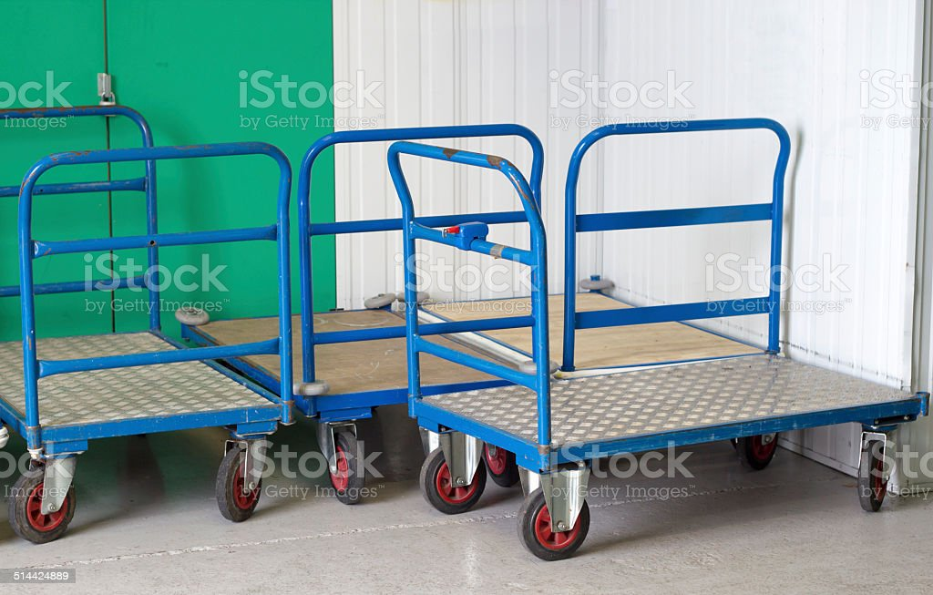 Removal trolleys at self storage stock photo
