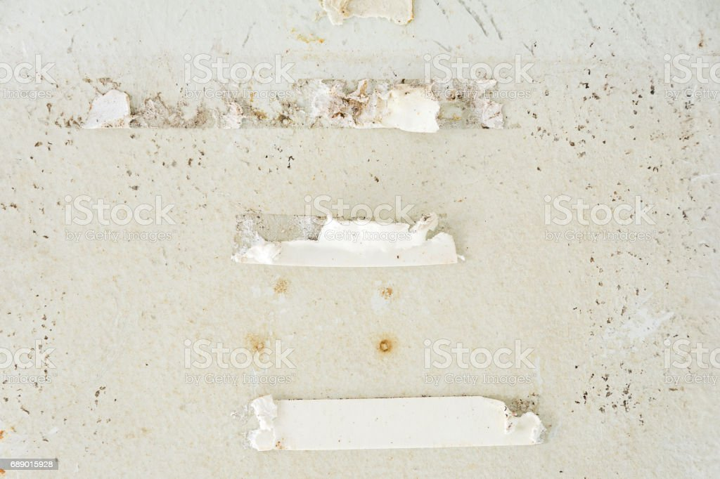 Remove Double Sided Foam Tape from wall stock photo
