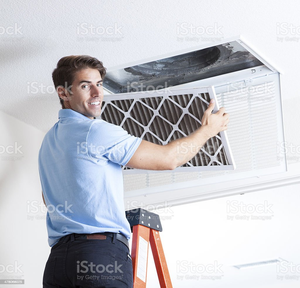 Removing Air Filter stock photo