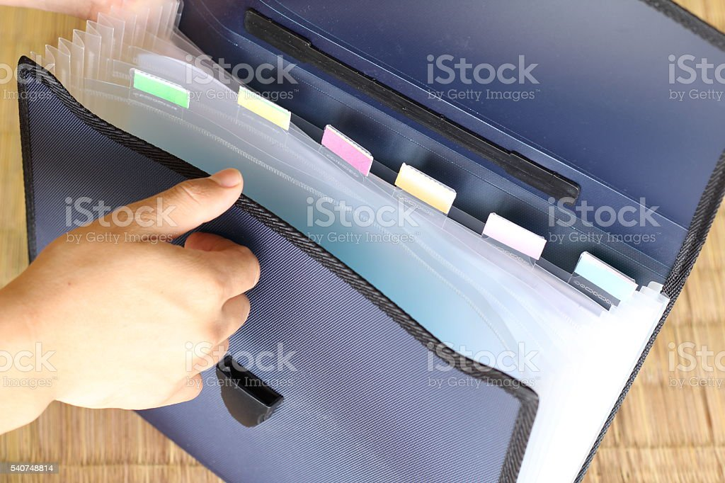 removing document from briefcase stock photo