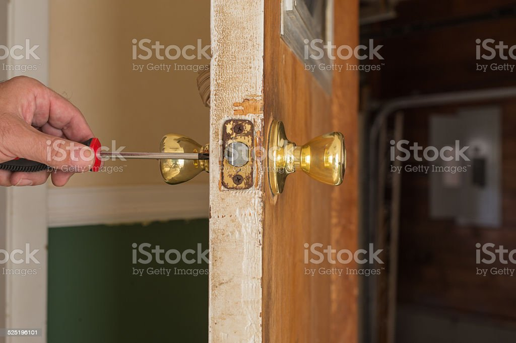 Removing Door Knob stock photo