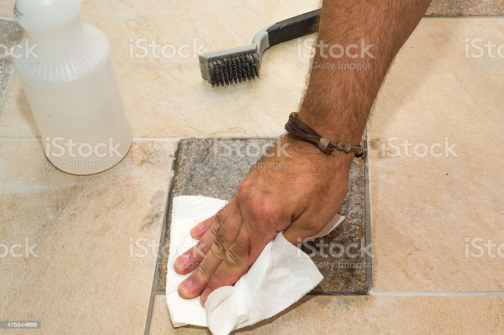 Removing Excess Grout From Tile, Wipe Off , Slide 3, DIY stock photo