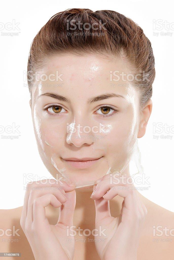 removing facial mask royalty-free stock photo