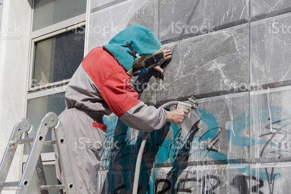 Removing graffiti stock photo