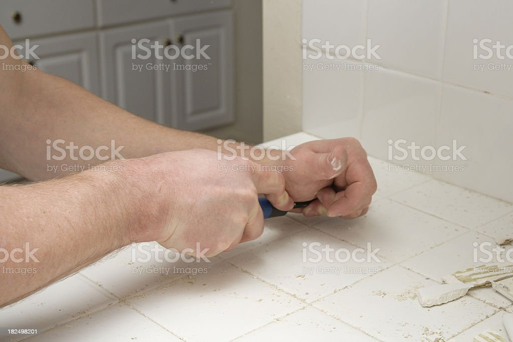 Removing Grout from Kitchen Tiles stock photo