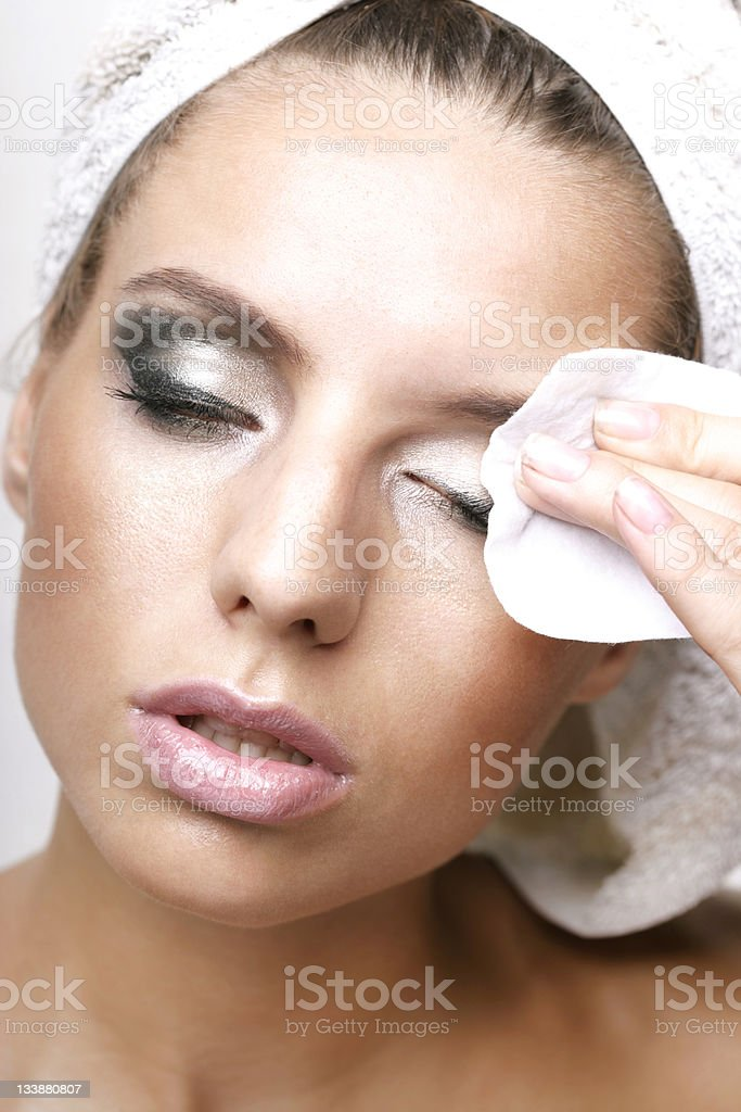 Removing makeup - female face stock photo