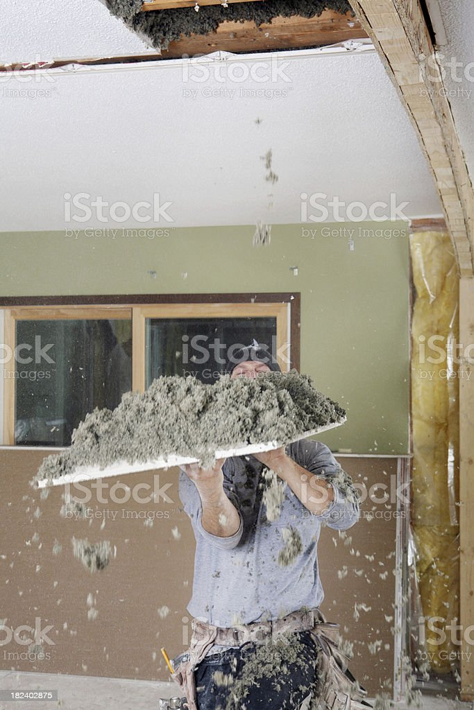 Removing Old, Inefficient Insulation royalty-free stock photo