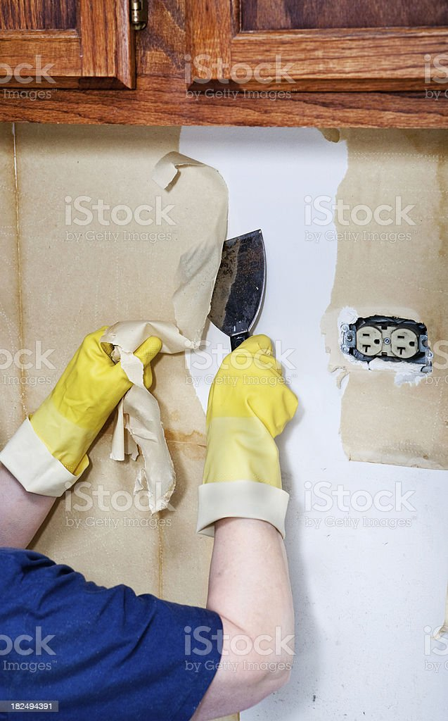 removing old wallpaper backing II royalty-free stock photo
