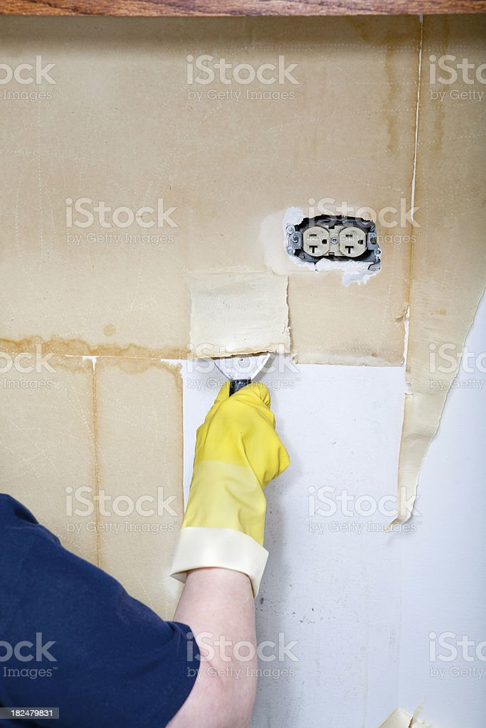 removing old wallpaper backing IV stock photo
