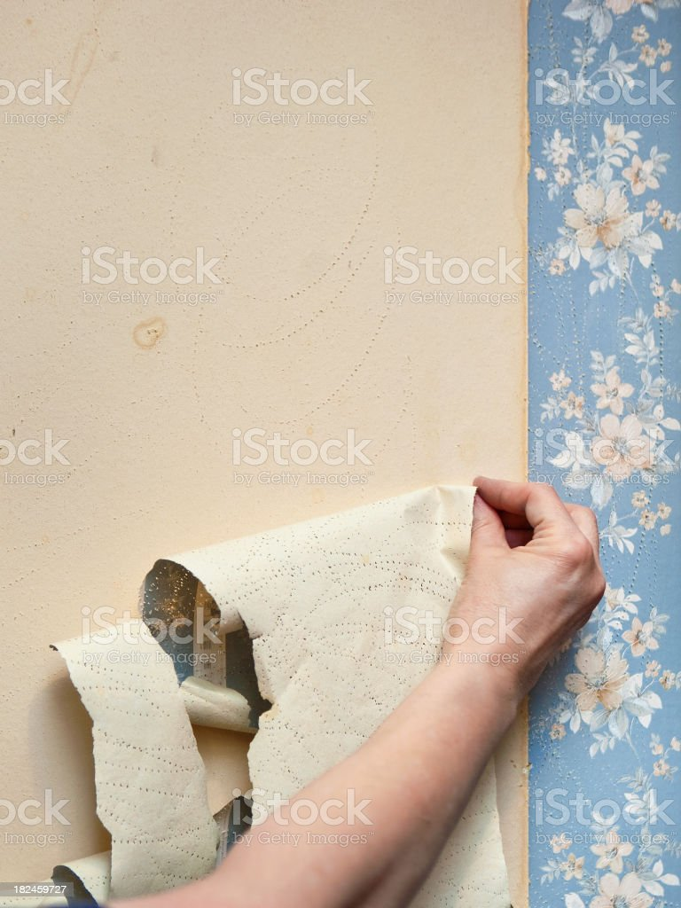 removing old wallpaper I stock photo