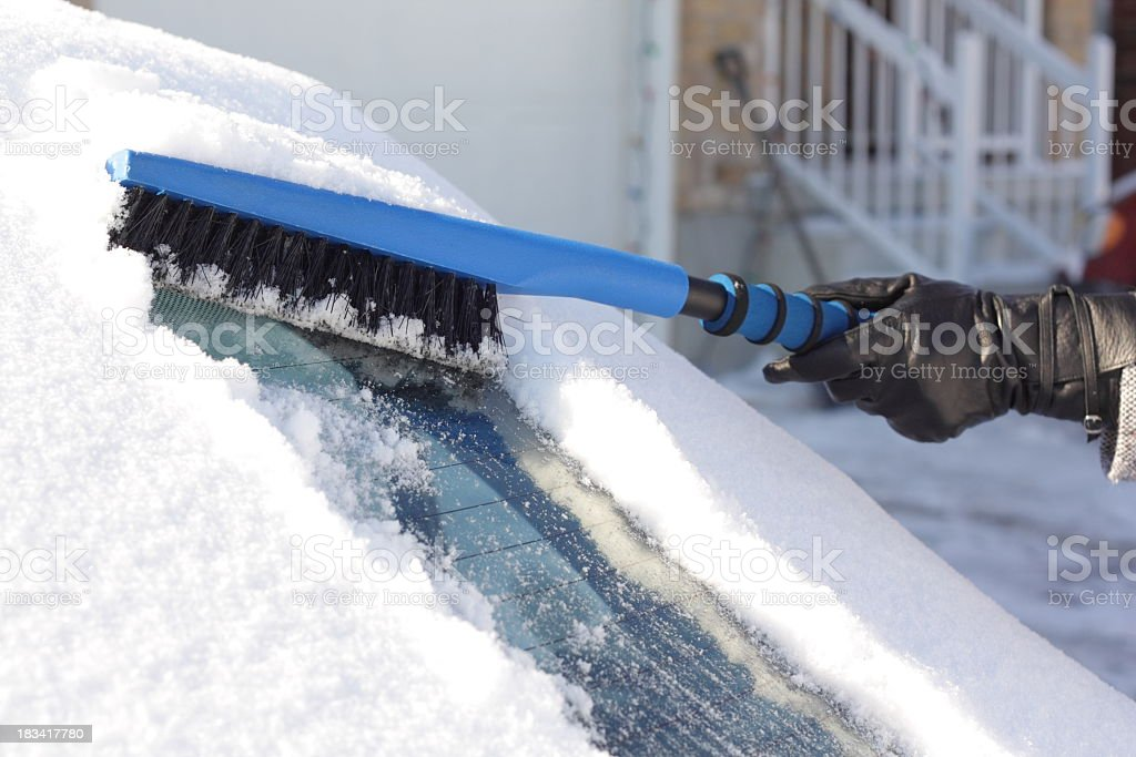 Removing Snow from Car stock photo