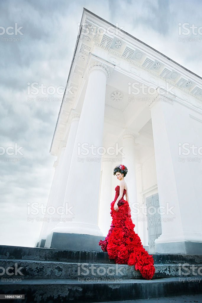 Renaissance woman at the steps of white columned building stock photo