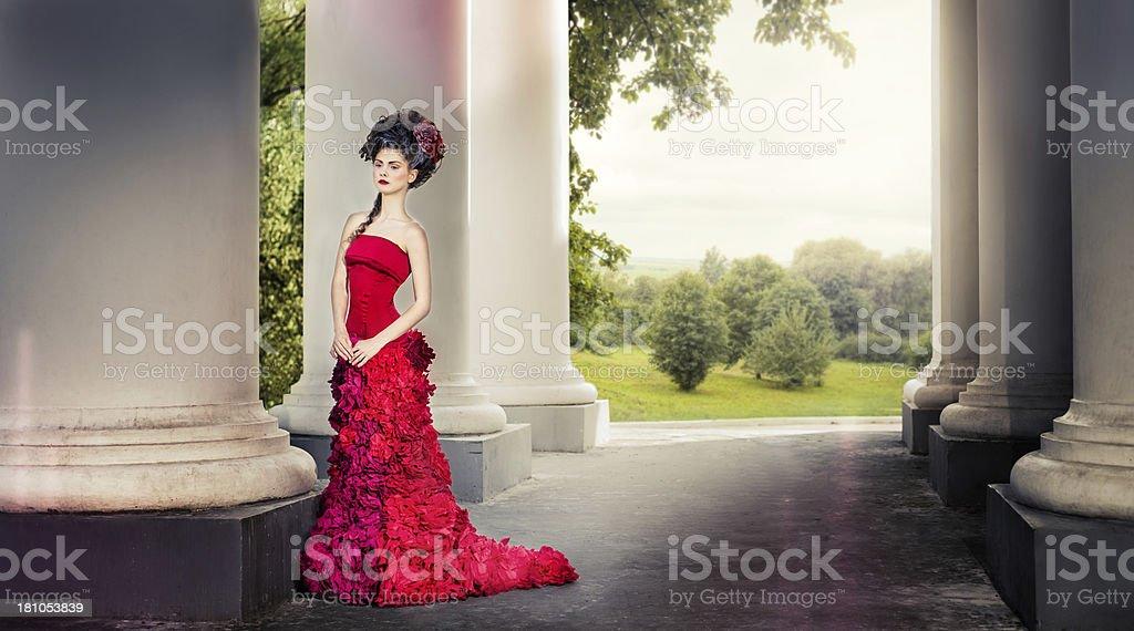 Renaissance woman between columns of white building stock photo