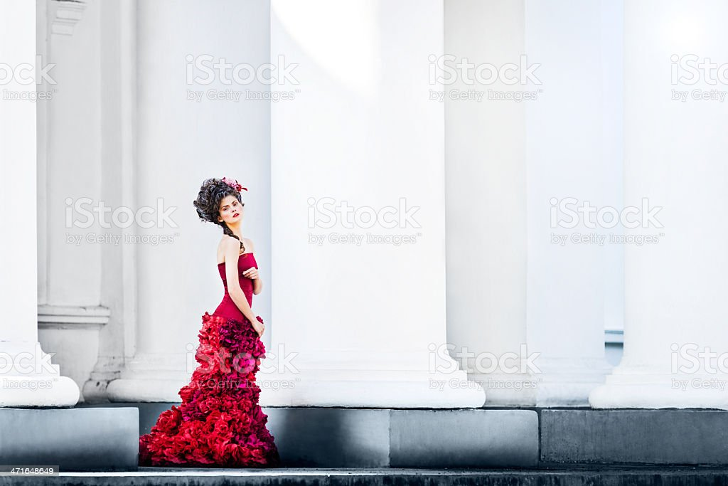 Renaissance woman between columns of white building royalty-free stock photo