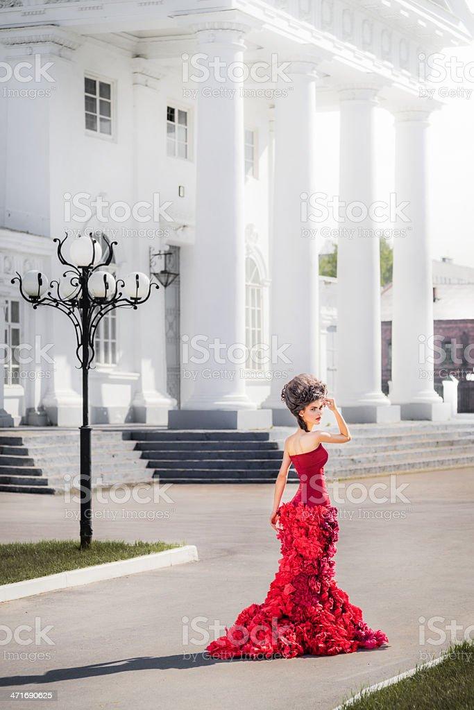 Renaissance woman between near white building stock photo