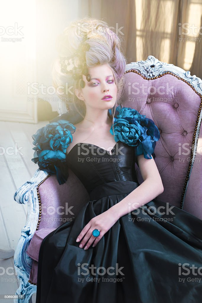Renaissance woman in chair stock photo