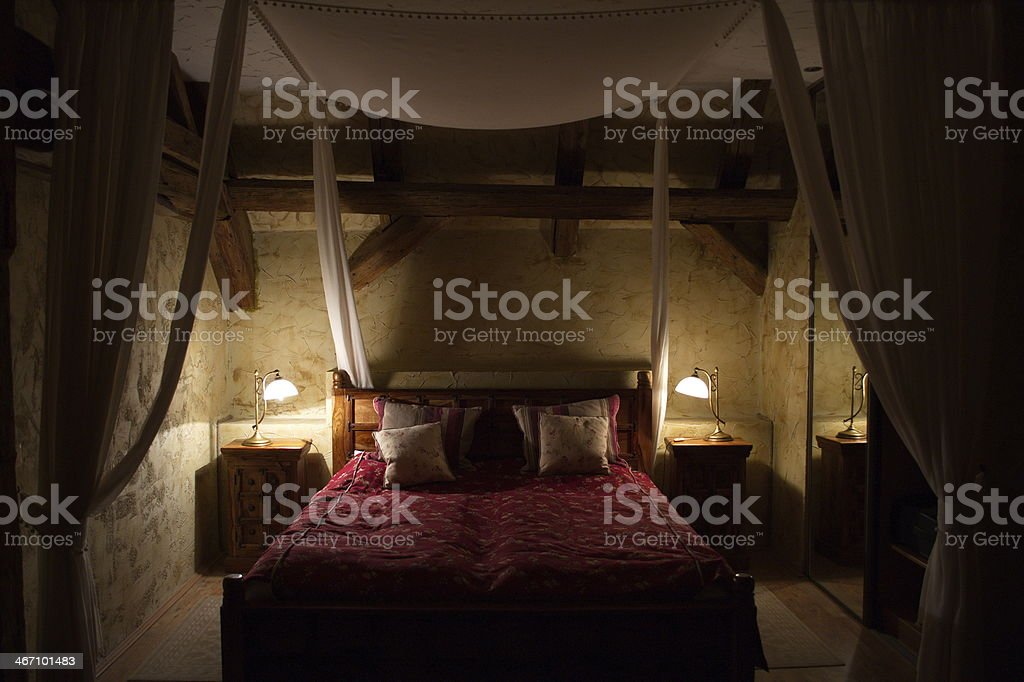 Renascence  Bed in the dark stock photo