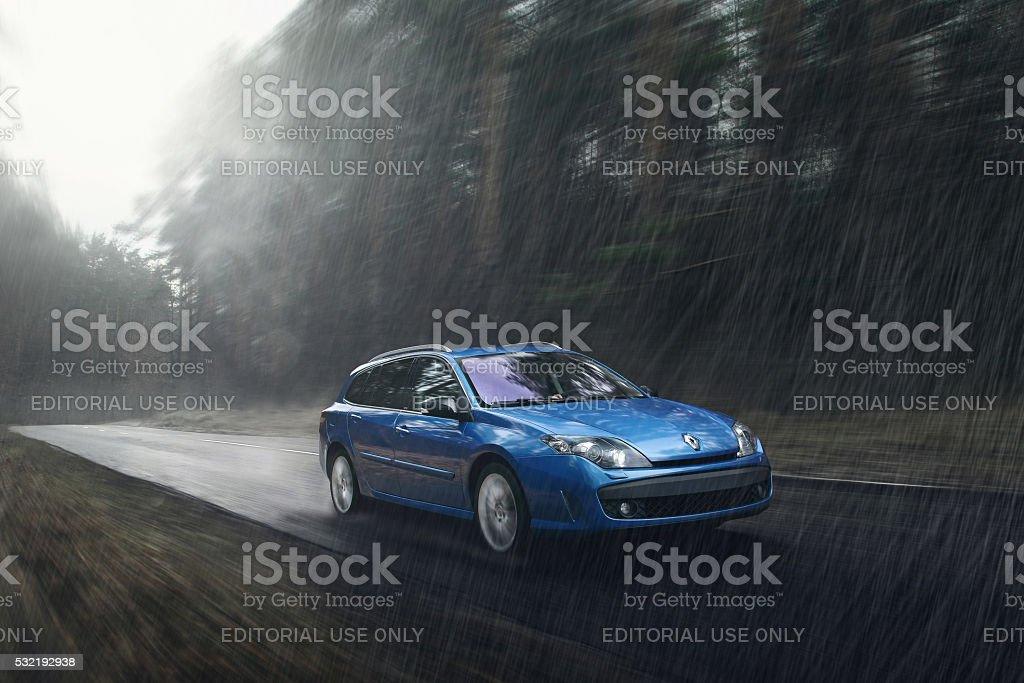 Renault Laguna car on road at rain stock photo